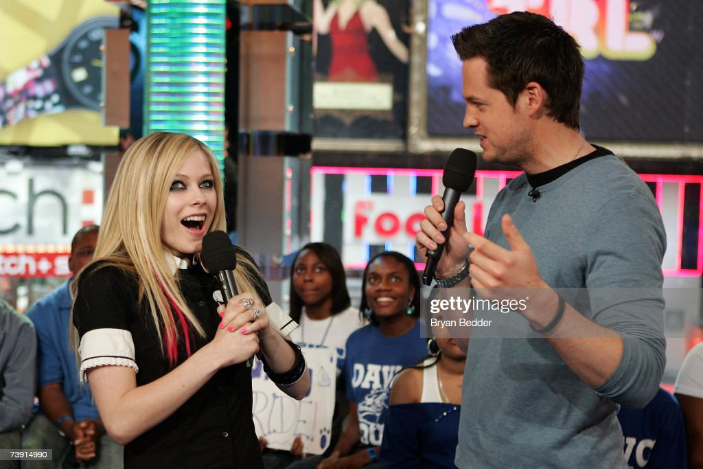 Musician Avril Lavigne appears onstage with MTV VJ Damien Fahey during MTV's Total Request Live at the MTV Times Square Studios on April 16, 2007 in New York City.
