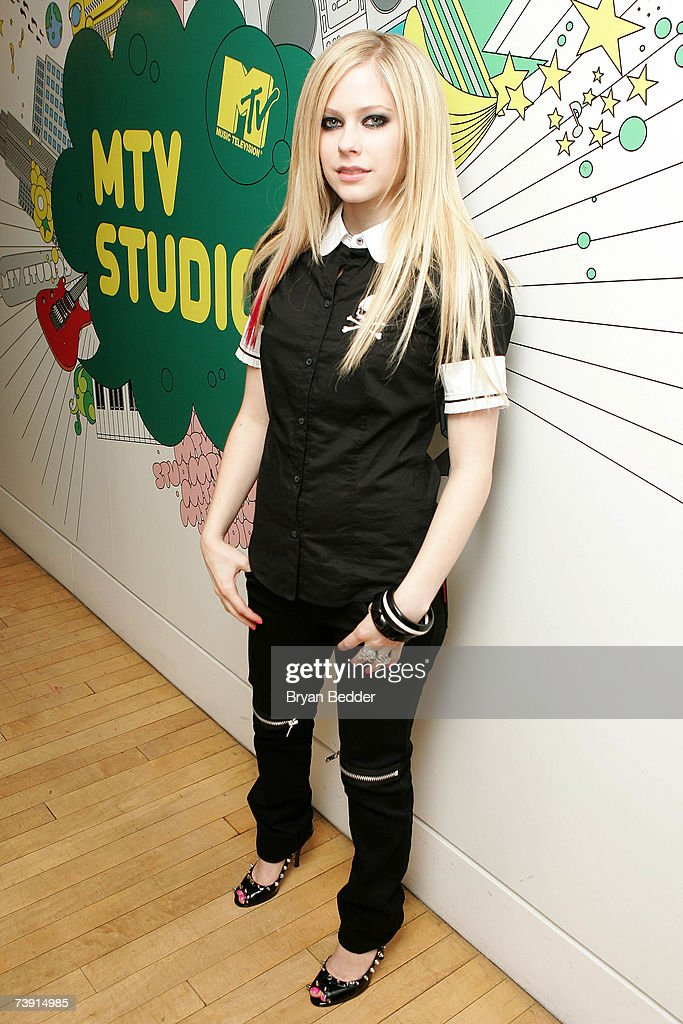 Musician Avril Lavigne poses backstage during MTV's Total Request Live at the MTV Times Square Studios on April 16, 2007 in New York City.