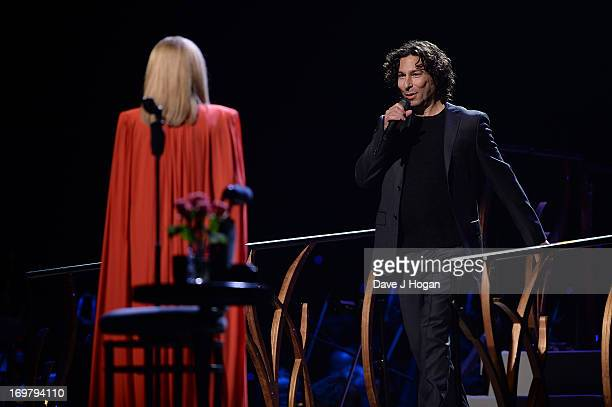 Musician Barbra Streisand performs on stage with her son Jason Gould in concert at O2 Arena on June 1 2013 in London England