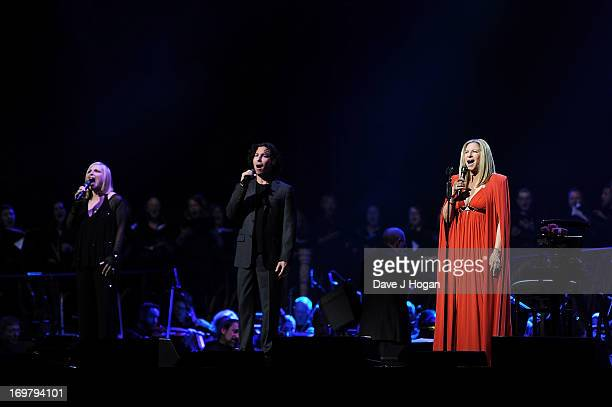 Musician Barbra Streisand performs with her sister Roslyn Kind and son Jason Gould on stage in concert at O2 Arena on June 1 2013 in London England