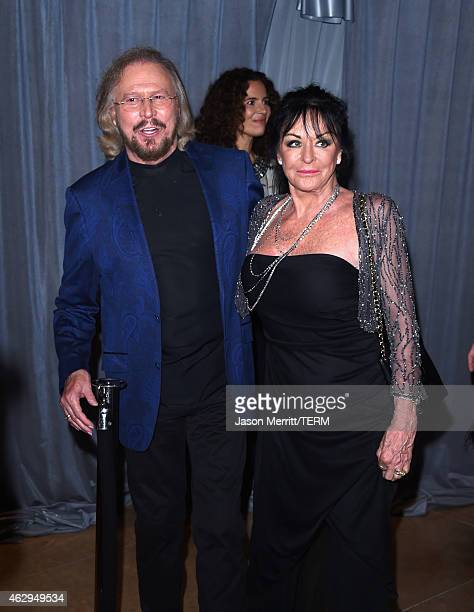 Musician Barry Gibb and Linda Ann Gray attend the Pre-GRAMMY Gala and Salute To Industry Icons honoring Martin Bandier at The Beverly Hilton Hotel on...