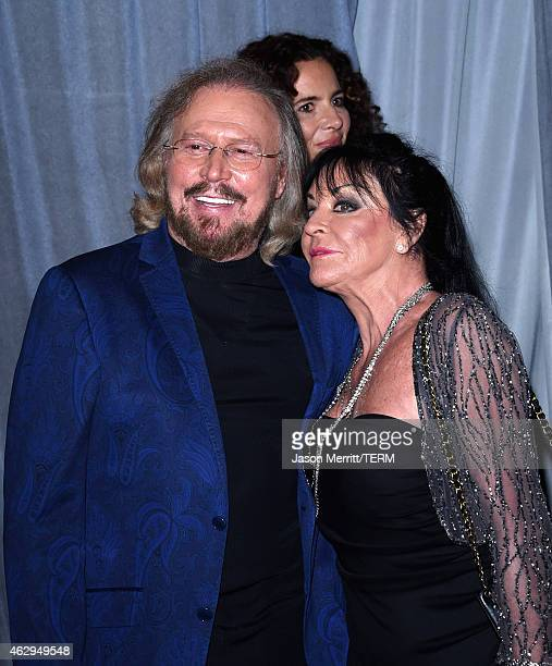 Musician Barry Gibb and Linda Ann Gray attend the PreGRAMMY Gala and Salute To Industry Icons honoring Martin Bandier at The Beverly Hilton Hotel on...