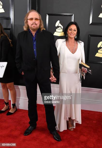 Musician Barry Gibb and Linda Gray attend The 59th GRAMMY Awards at STAPLES Center on February 12 2017 in Los Angeles California