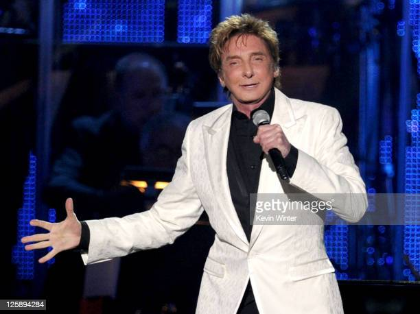 Musician Barry Manilow performs onstage at 2011 MusiCares Person of the Year Tribute to Barbra Streisand at Los Angeles Convention Center on February...