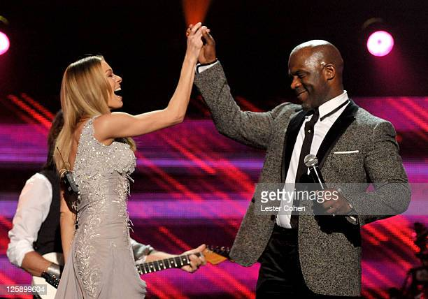 Musician BeBe Winans performs onstage at 2011 MusiCares Person of the Year Tribute to Barbra Streisand at Los Angeles Convention Center on February...