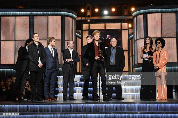 Musician Beck accepts Album of the Year award from Prince onstage during The 57th Annual GRAMMY Awards at the STAPLES Center on February 8, 2015 in...