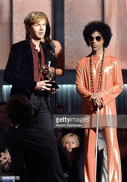 Musician Beck accepts Album of the Year for 'Morning Phase,' as musician Prince looks on, onstage during The 57th Annual GRAMMY Awards at the at the...