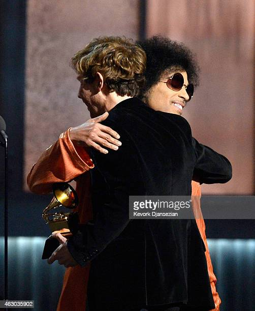 """Musician Beck accepts the Album of the Year award for """"Morning Phase"""" from musician Prince onstage during The 57th Annual GRAMMY Awards at the at the..."""