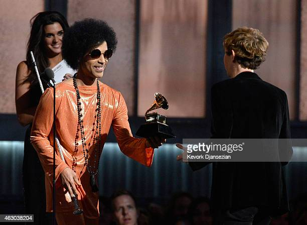 Musician Beck accepts the Album of the Year award for Morning Phase from musician Prince onstage during The 57th Annual GRAMMY Awards at the at the...