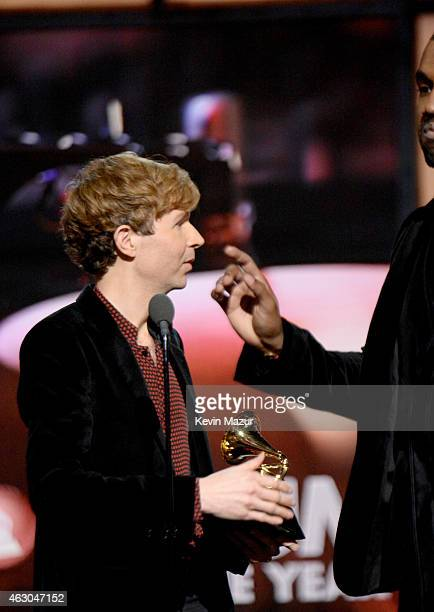Musician Beck and Kanye West speak onstage during The 57th Annual GRAMMY Awards at the STAPLES Center on February 8 2015 in Los Angeles California