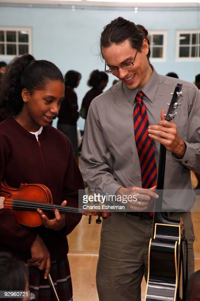 Musician Ben Jelen rehearses with Honors Violin Ensemble students for the Ten O'Clock Classics 6th annual Charity gala at Mount Carmel Holy Rosary...