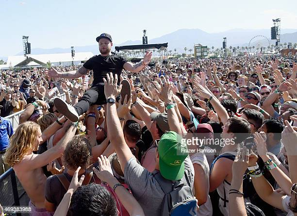 Musician Ben Thatcher of Royal Blood crowd surfs in the audience during day 2 of the 2015 Coachella Valley Music Arts Festival at the Empire Polo...