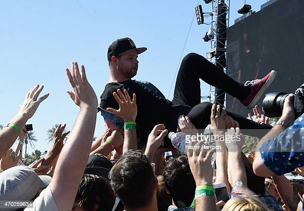 Musician Ben Thatcher of Royal Blood jumps into the crowd during day 2 of the 2015 Coachella Valley Music And Arts Festival at The Empire Polo Club...