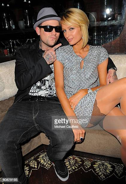 """Musician Benji Madden and Paris Hilton pose during the """"Glow in the Dark Tour 2008"""" party ignited by Absolute 100 held at GOA on April 22, 2008 in..."""