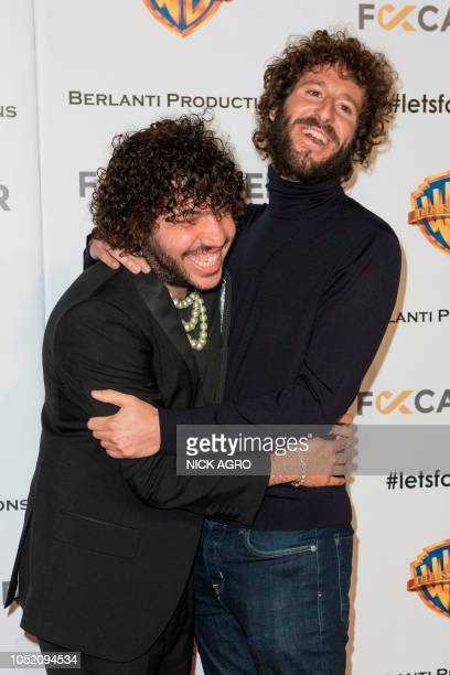 US musician Benny Blanco and US musician and actor Lil Dicky arrive for the F*ck Cancer Gala October 13 2018 at Warner Bros Studio in Burbank...