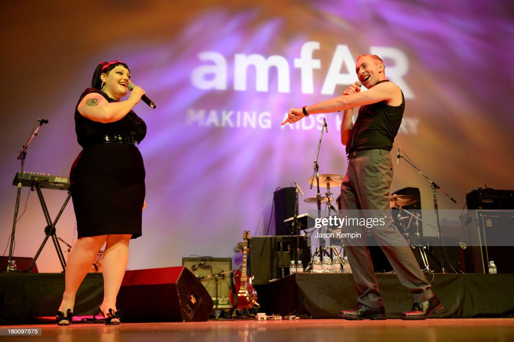 Musician Beth Ditto of band Gossip onstage with actor Alan Cumming at amfAR Inspiration Gala during the 2013 Toronto International Film Festival on September 8, 2013 in Toronto, Canada.