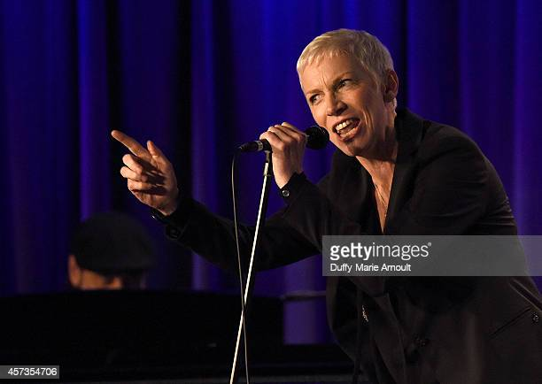 Musician Bill Steinway and singer Annie Lennox perform at The Drop Annie Lennox at The GRAMMY Museum on October 16 2014 in Los Angeles California