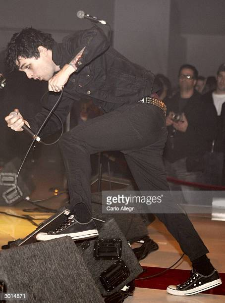 Musician Billie Joe Armstrong gestures as he performs during the 3rd Annual 'ten' fashion show and charity event to celebrate awards season and car...