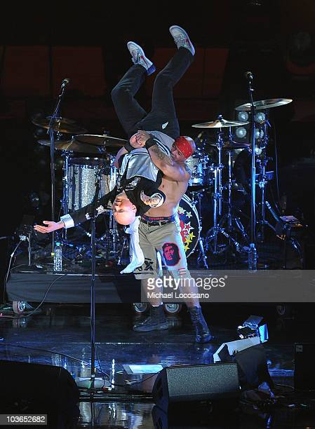 Musician Billy Corgan of the Smashing Pumpkins wrestles with a Mexican wrestler during the 2010 MTV World Stages concert at the Auditorio Nacional on...