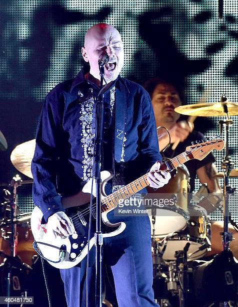 Musician Billy Corgan performs onstage during day two of the 25th annual KROQ Almost Acoustic Christmas at The Forum on December 13 2014 in Inglewood...