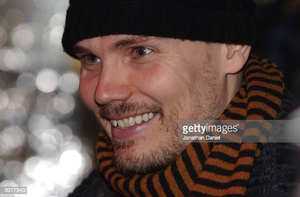 Musician Billy Corgan talks with members of the media before the ceremony to destroy the cursed Chicago Cubs baseball on February 26 2004 at Harry...