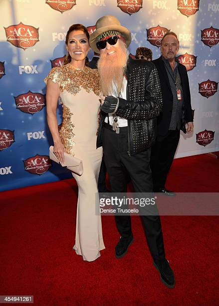 Musician Billy Gibbons of ZZ Top and wife Gilligan Stillwater arrive at the American Country Awards 2013 at the Mandalay Bay Events Center on...