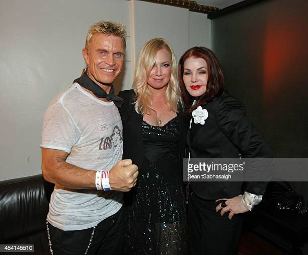 Musician Billy Idol actress Tracy Lords and Priscilla Presley pose back stage at the Johnny Ramone 10th Anniversary Celebration at Hollywood Forever...