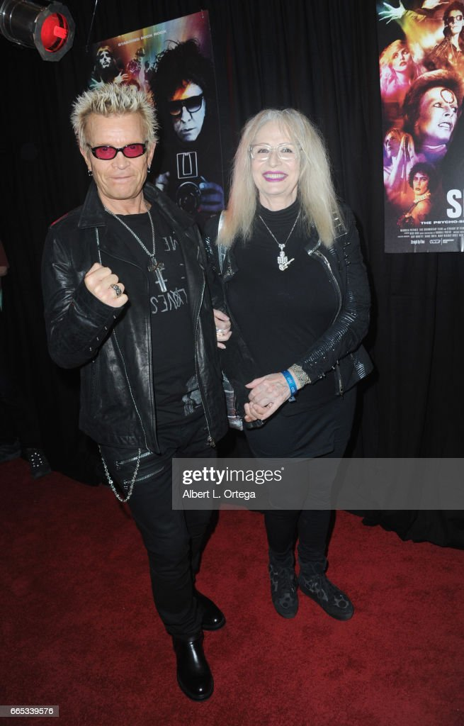 Musician Billy Idol and director Penelope Spheeris arrive for the Premiere Of 'SHOT! The Psycho-Spiritual Mantra of Rock' held at Pacific Theatres at The Grove on April 5, 2017 in Los Angeles, California.
