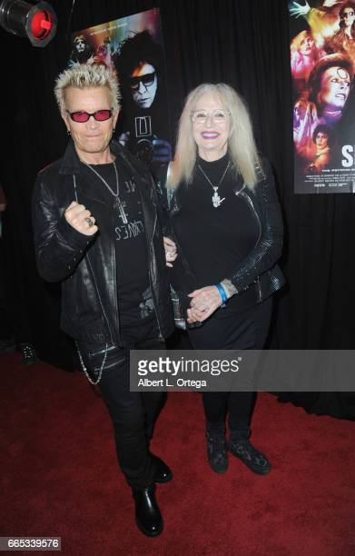 Musician Billy Idol and director Penelope Spheeris arrive for the Premiere Of SHOT The PsychoSpiritual Mantra of Rock held at Pacific Theatres at The...