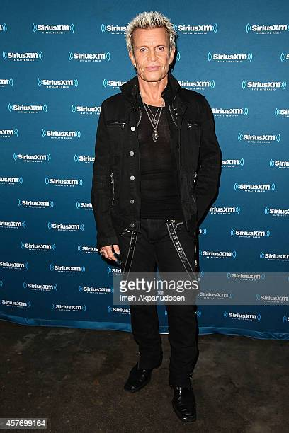 Musician Billy Idol poses backstage before performing for SiriusXM's Artist Confidential Series at The Troubadour on October 22 2014 in Los Angeles...