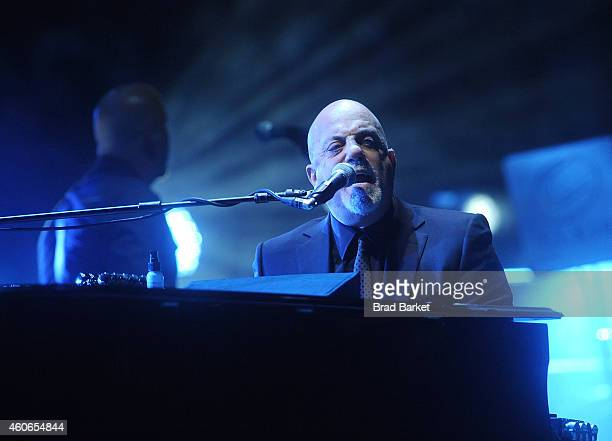 Musician Billy Joel performs at Madison Square Garden on December 18, 2014 in New York City.