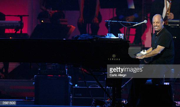 Musician Billy Joel performs on stage during the Andre Agassi Foundation's 8th Annual Grand Slam for Children benefit concert at the MGM Grand Garden...