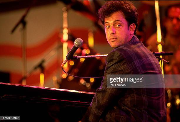 Musician Billy Joel performs onstage during the first Farm Aid benefit concert at Memorial Stadium Champaign Illinois September 22 1985