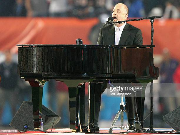 Musician Billy Joel performs the National Anthem prior to the start of Super Bowl XLI between the Indianapolis Colts and the Chicago Bears on...