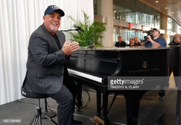 Musician Billy Joel poses at the piano after a press conference at Madison Square Garden July 18, 2018 to celebrate his achievement of 100 lifetime...