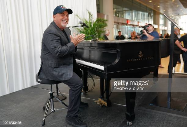 Musician Billy Joel poses at the piano after a press conference at Madison Square Garden July 18 2018 to celebrate his achievement of 100 lifetime...