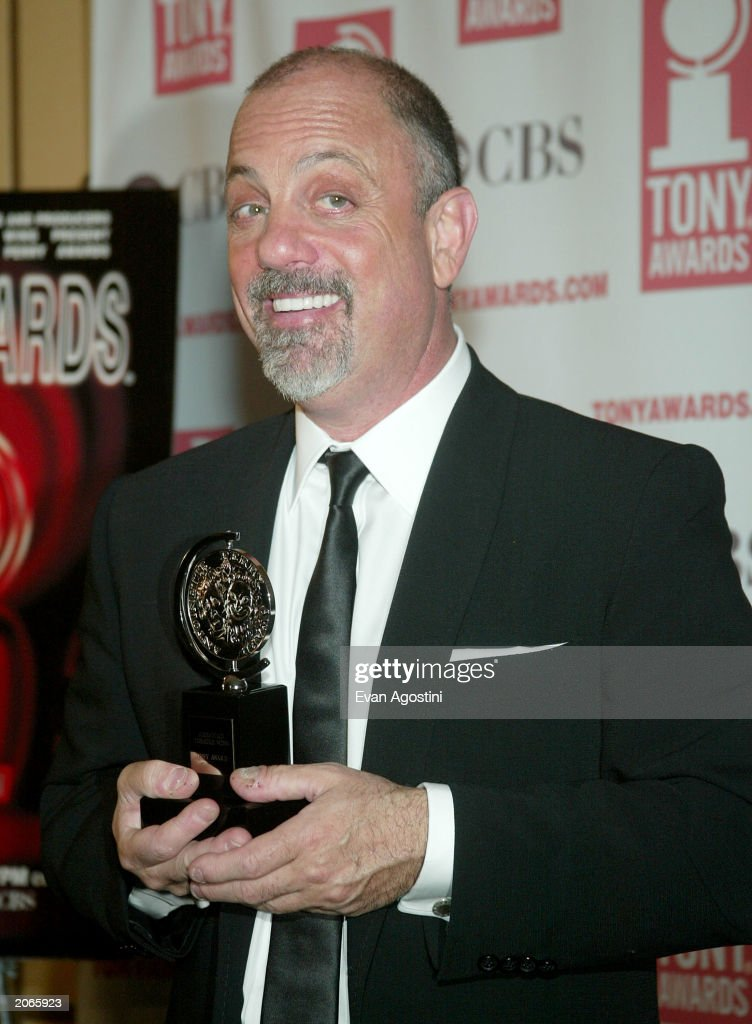 Musician Billy Joel poses backstage after winning win Best Orchestration for 'Movin' Out' at the '57th Annual Tony Awards' at Radio City Music Hall on June 8, 2003 in New York City. The Tony Awards are presented by the League of American Theatres and Producers and the American Theatre Wing.