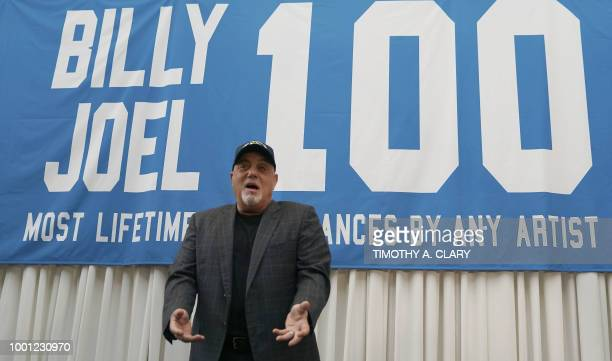 Musician Billy Joel poses under a banner at a press conference at Madison Square Garden July 18 2018 to celebrate his achievement of 100 lifetime...