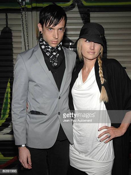 Musician Billy Martin of Good Charlotte and guest arrive at the DCMA Collective flagship store opening on March 14 2008 in Los Angeles California