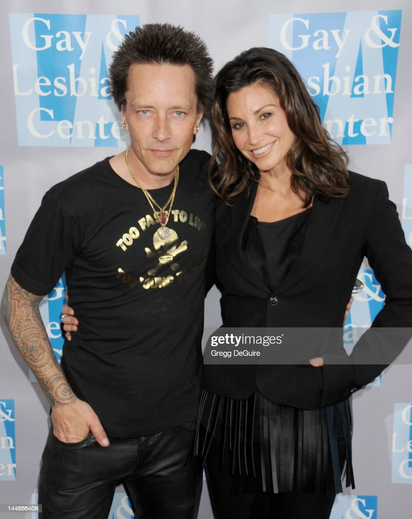 Musician Billy Morrison and actress Gina Gershon arrive at the L.A. Gay & Lesbian Center's 'An Evening With Women' at The Beverly Hilton Hotel on May 19, 2012 in Beverly Hills, California.