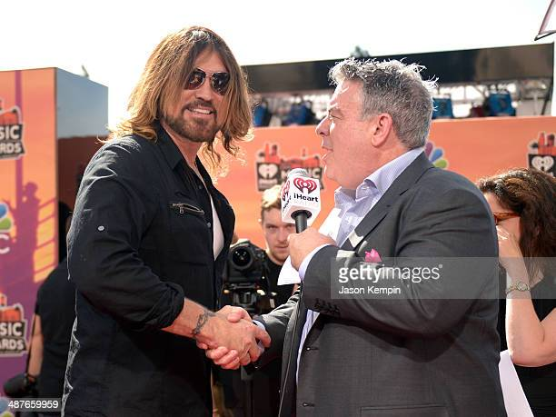 Musician Billy Ray Cyrus and radio personality Elvis Duran attend the 2014 iHeartRadio Music Awards held at The Shrine Auditorium on May 1 2014 in...