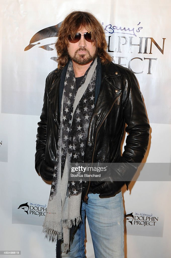 Musician Billy Ray Cyrus arrives at the Avalon for Kings of Chaos Tokyo Celebrates The Dolphin Benefit Concert on November 18, 2013 in Hollywood, California.