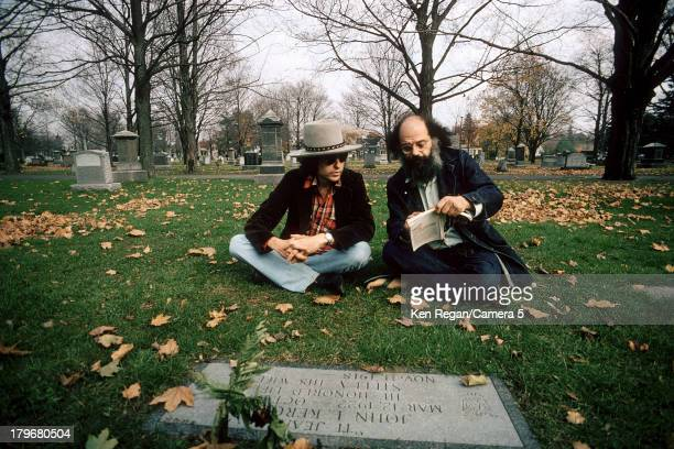 Musician Bob Dylan and poet Allen Ginsberg are photographed at Jack Keuroac's grave during the Rolling Thunder Revue in October 1975 in Lowell...