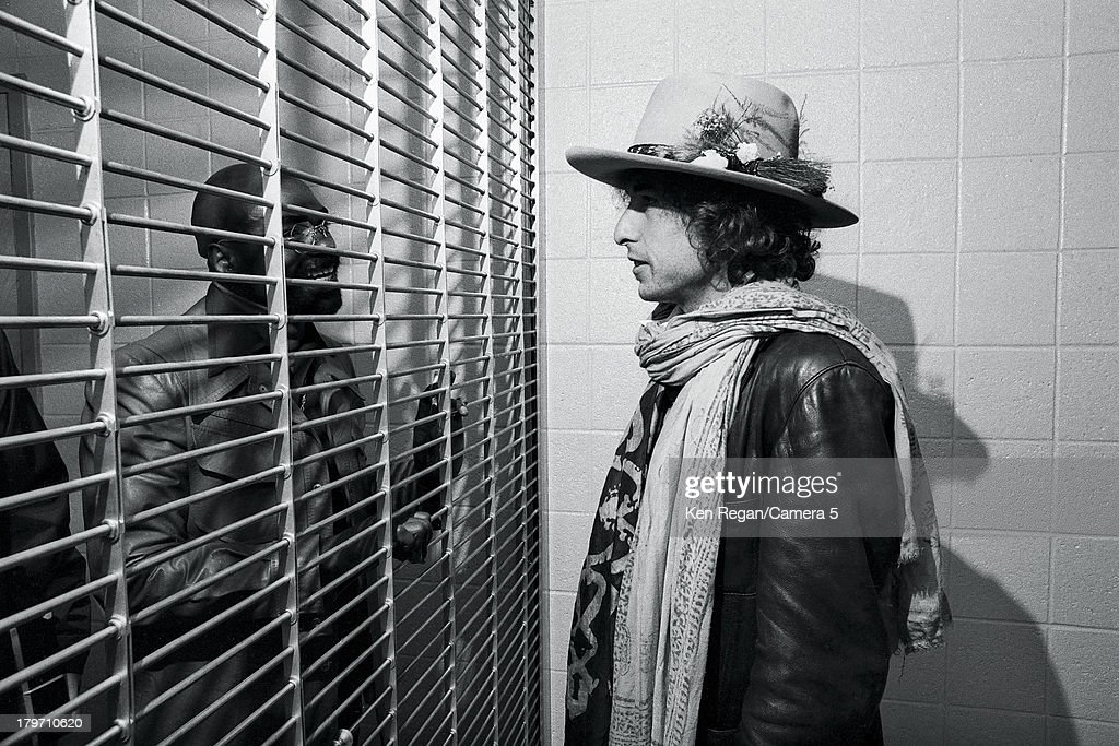 Musician Bob Dylan is photographed visiting Rubin 'Hurricane' Carter at New Jersey's Clinton State Prison during the Rolling Thunder Revue on December 7, 1975 in Clinton, New Jersey.