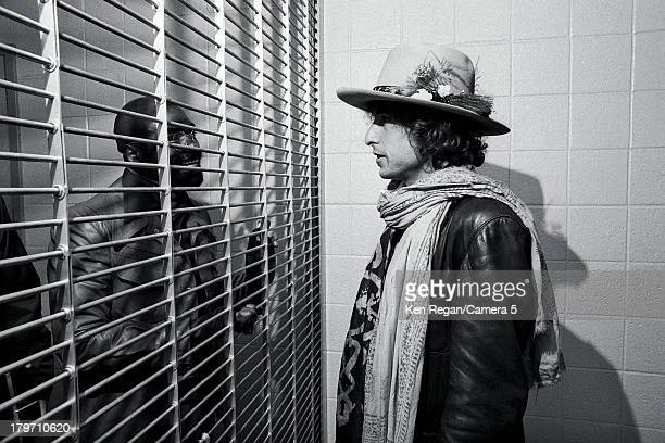 Musician Bob Dylan is photographed visiting Rubin 'Hurricane' Carter at New Jersey's Clinton State Prison during the Rolling Thunder Revue on...
