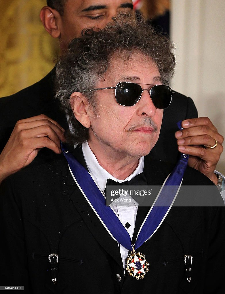 Musician Bob Dylan (R) is presented with a Presidential Medal of Freedom by U.S. President Barack Obama (L) during an East Room event May 29, 2012 at the White House in Washington, DC. The Medal of Freedom, the nation's highest civilian honor, is presented to individuals who have made especially meritorious contributions to the security or national interests of the United States, to world peace, or to cultural or other significant public or private endeavors.
