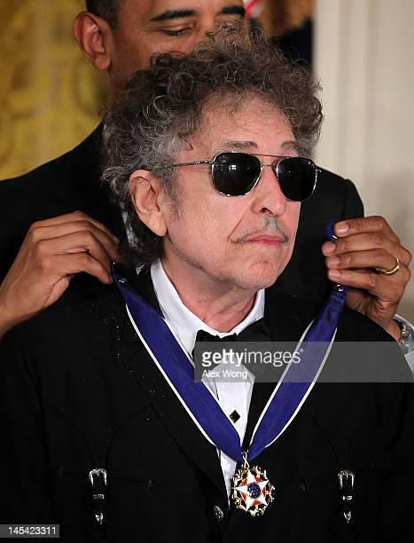 Musician Bob Dylan is presented with a Presidential Medal of Freedom by US President Barack Obama during an East Room event May 29 2012 at the White...