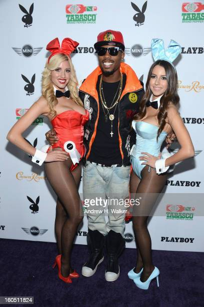 Musician BoB poses with Playboy Playmates at The Playboy Party Presented by Crown Royal on February 1 2013 in New Orleans Louisiana