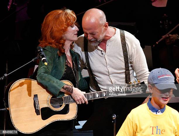 Musician Bonnie Raitt and actor Bruce Willis onstage during the reading of The World Of Nick Adams to honor Paul Newman held at Davies Symphony Hall...