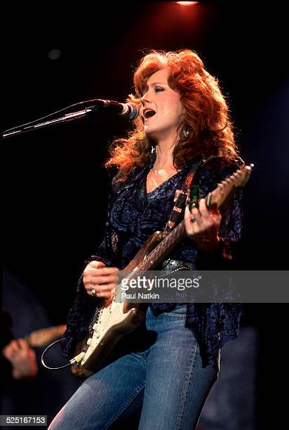Musician Bonnie Raitt performs at Farm Aid in the Hoosier Dome Indianapolis Indiana April 7 1990